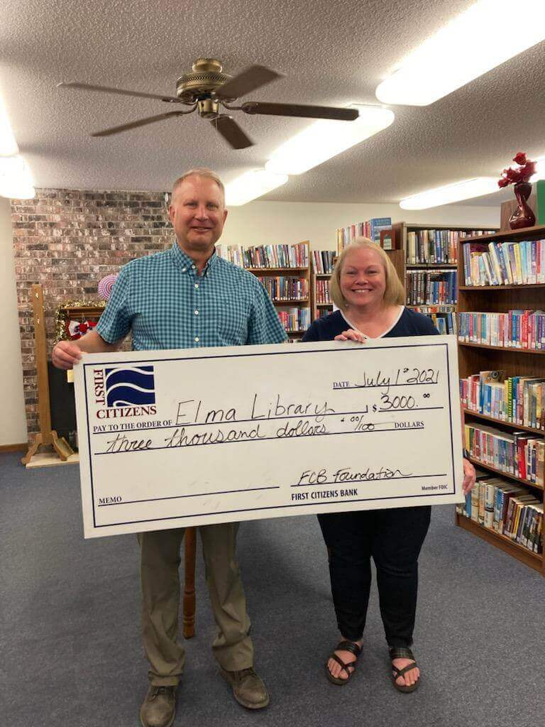 Bob Savre of First Citizens Bank in New Hampton presented a $3,000 grant check to Renee Burke, Elma Public Library Director.